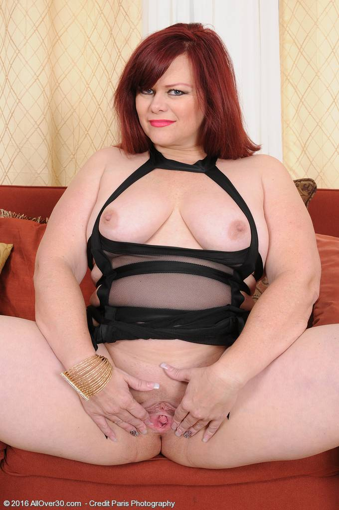 Busty curvy Marcy Diamond playing with her shaved pussy at AllOver30