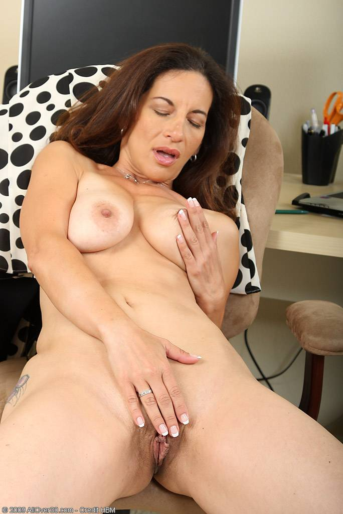 Brunette MILF displaying some hot mature ass at AllOver30