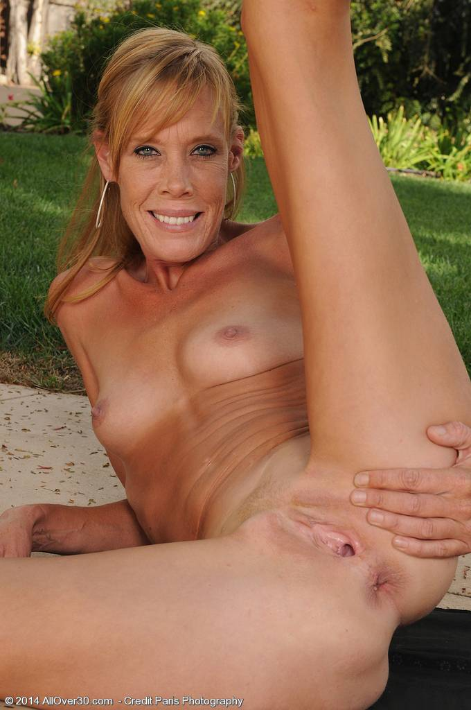 Beautiful MILF Stacey Y spreading on the grass outdoors at AllOver30