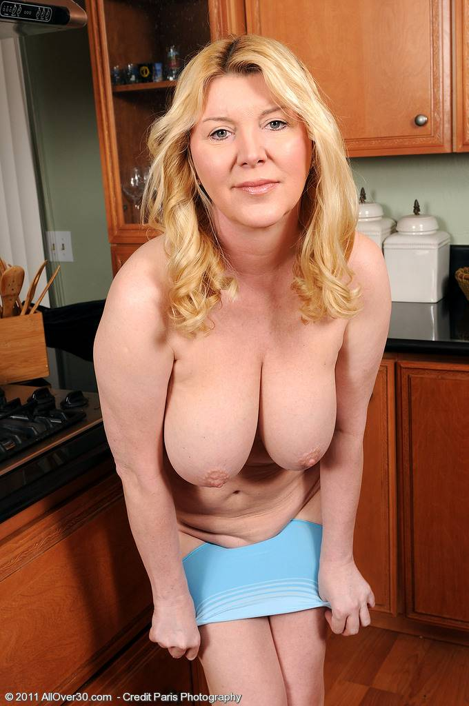 Beautiful 51 year old Venice in the kitchen spreading her pussy wide at AllOver30