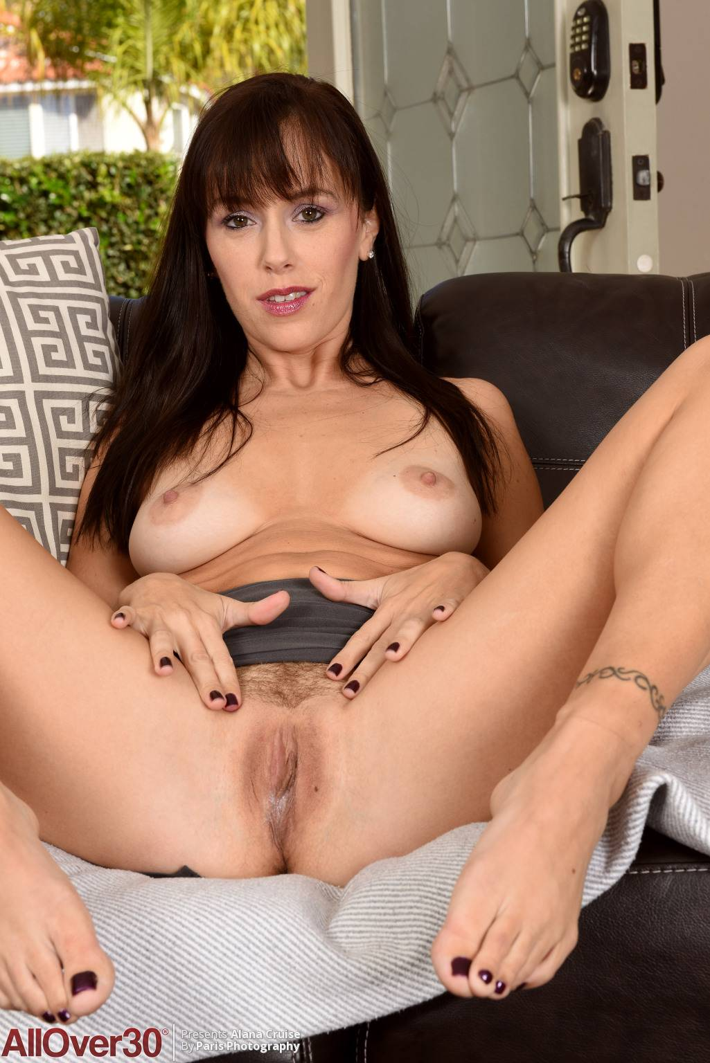 Sexy MILF Alana Cruise playing with her shaved pussy at AllOver30