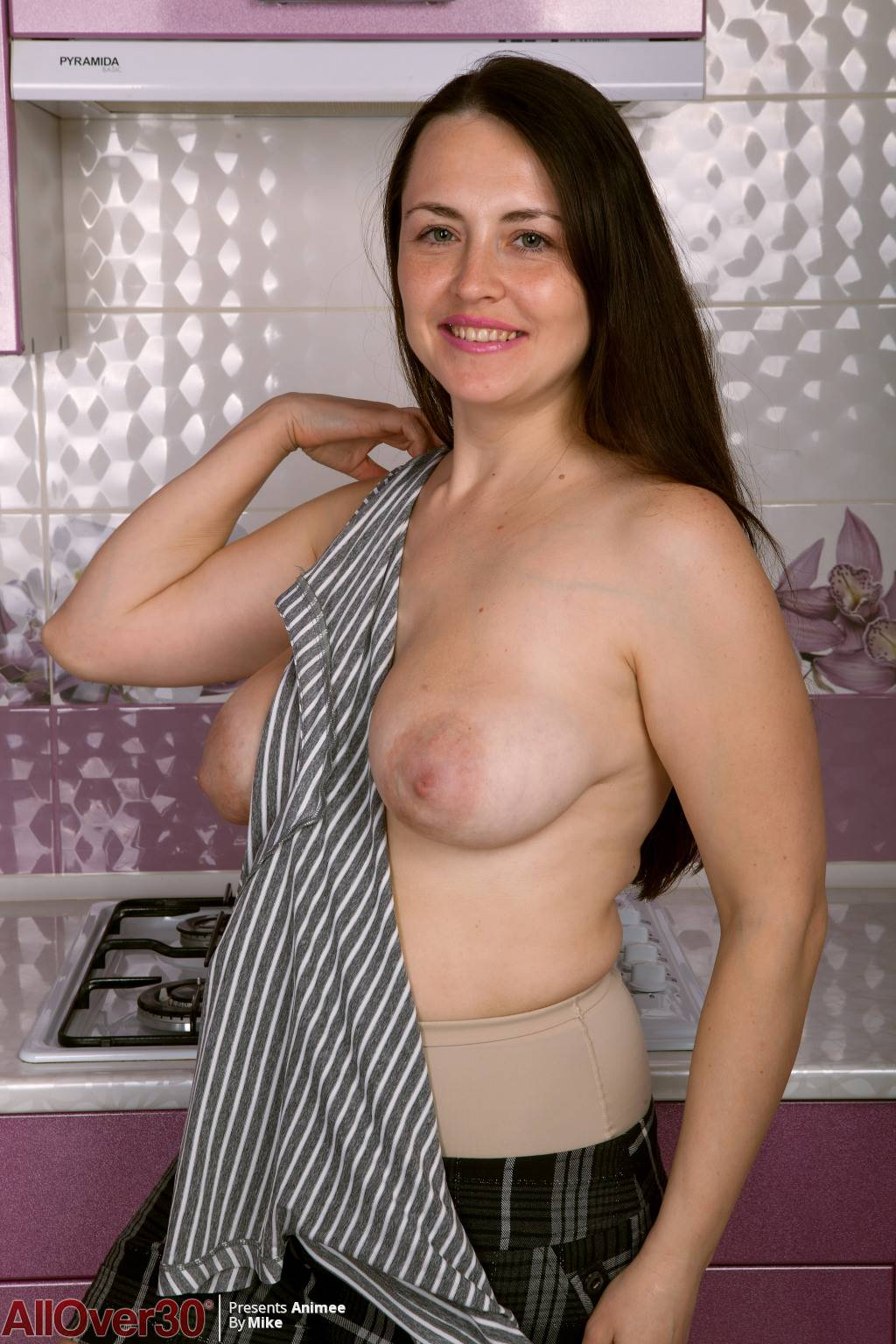 Naughty mom Animee with natural boobs playing in the kitchen at AllOver30