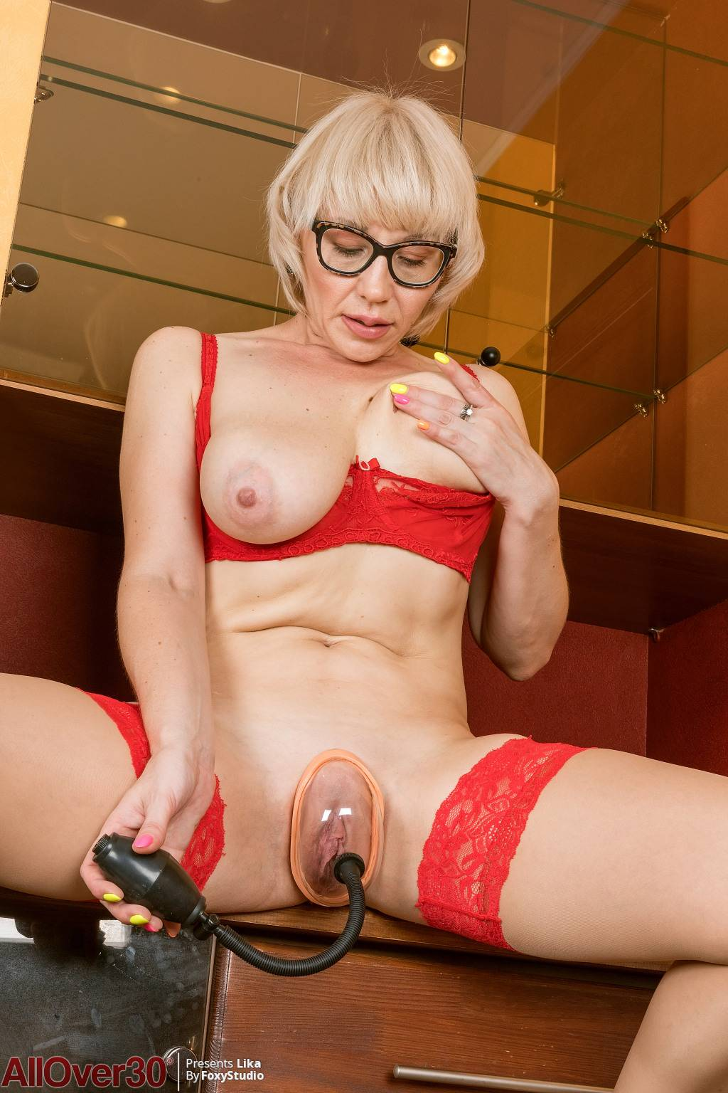 Blonde mature Lika playing with a pussy pump at AllOver30