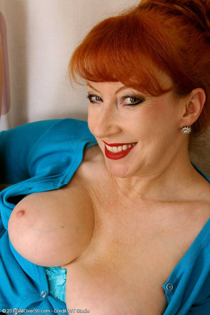 Redhead mature with panties playing with herself at AllOver30