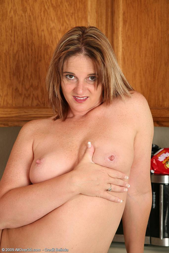 Busty MILF Stacellia displays her hot older body at AllOver30