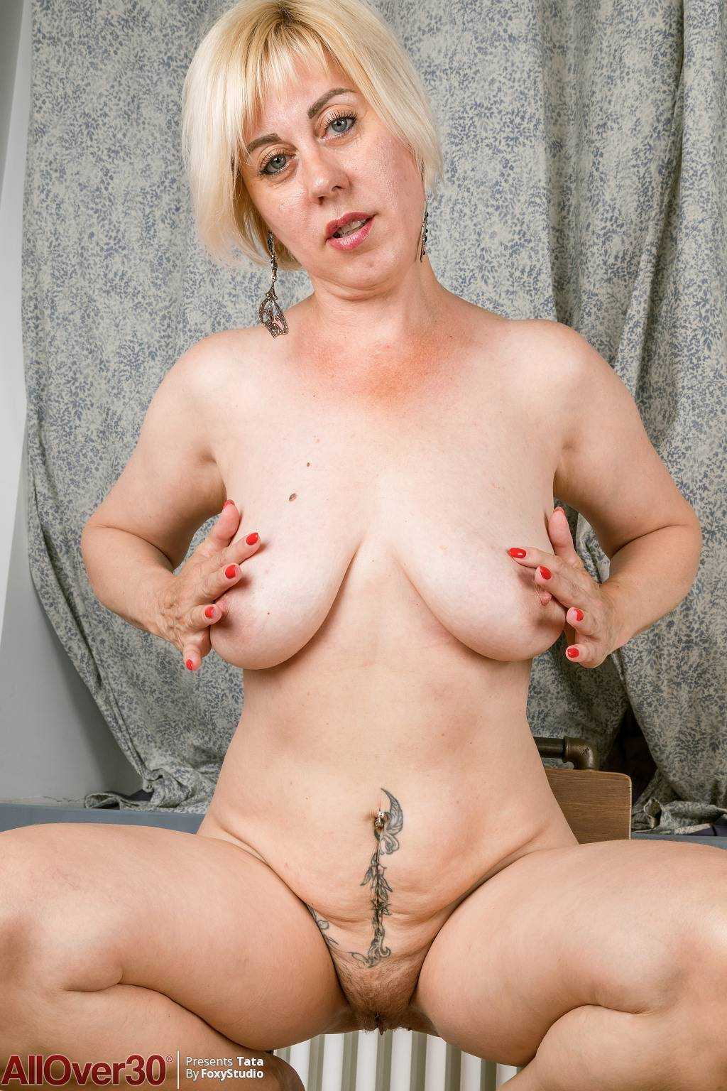 Blonde mature Tata playing with her unshaved pussy at AllOver30
