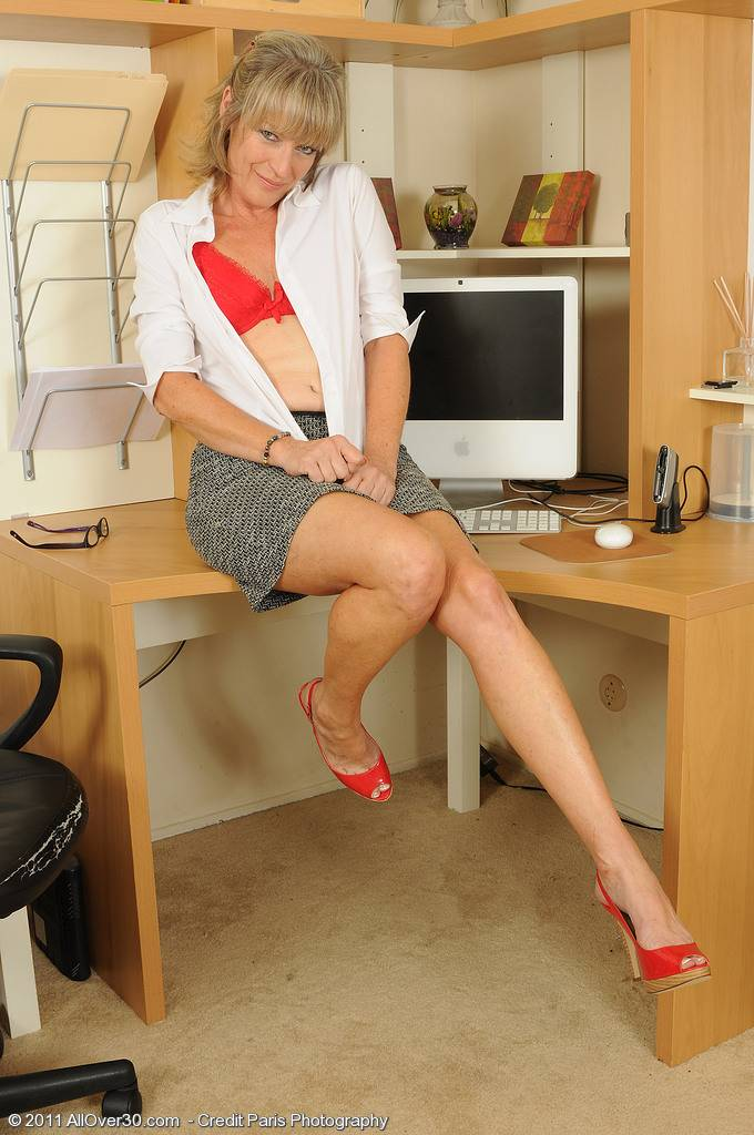 Mature Tina spreads her legs wide after work at AllOver30