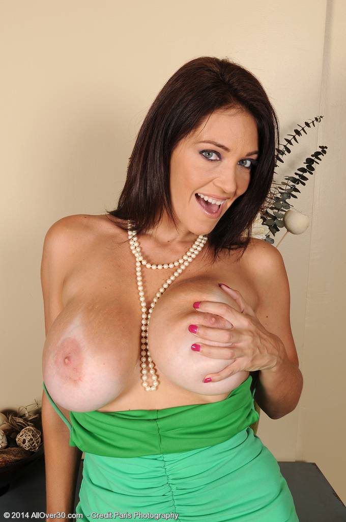 Brunette MILF Charlee Chase showing off her big juicy melons at AllOver30