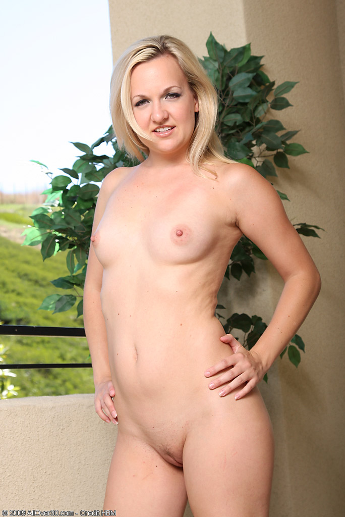 Blonde MILF Hanna S teases us on the balcony at AllOver30