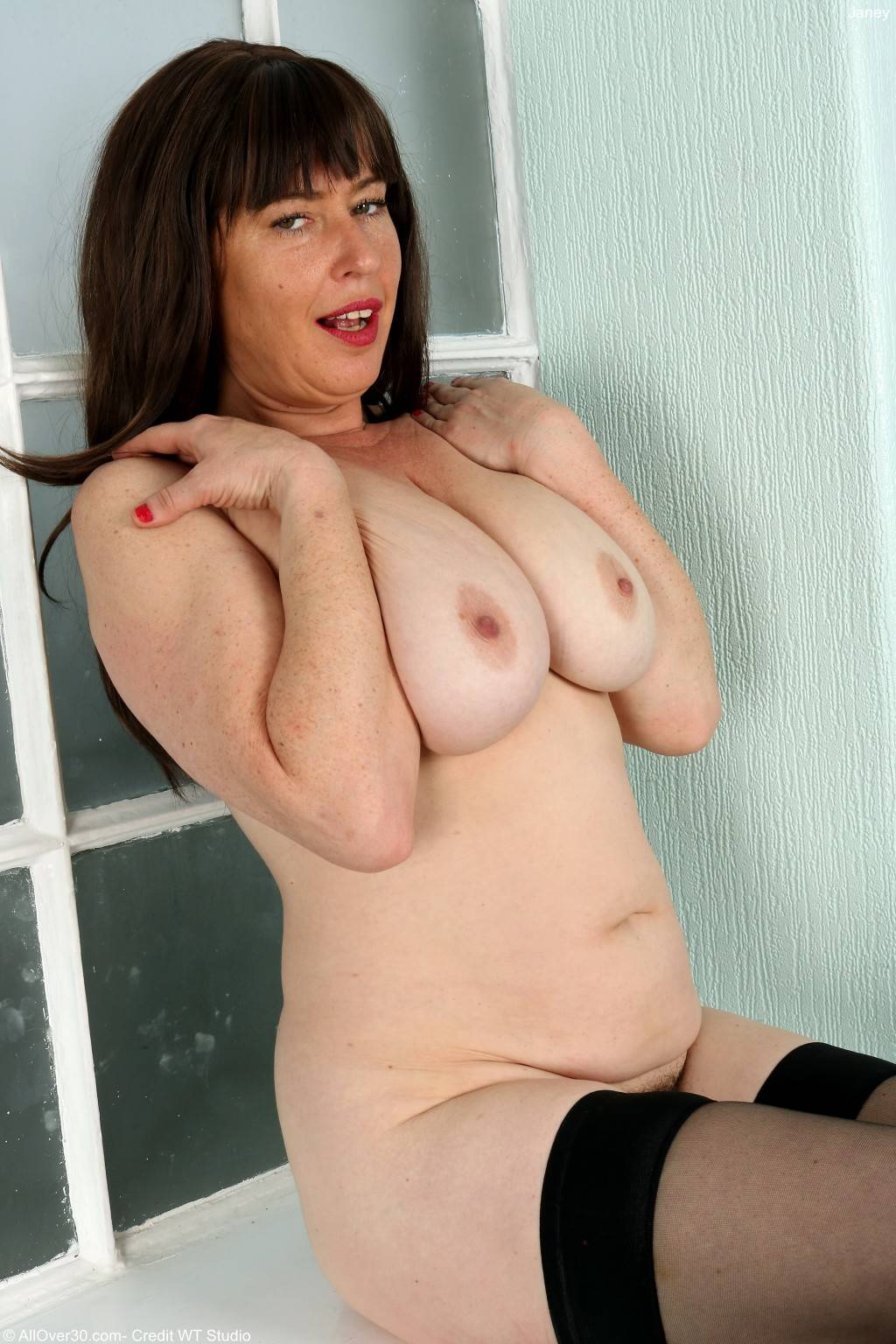 Busty hairy Janey playing with herself at AllOver30