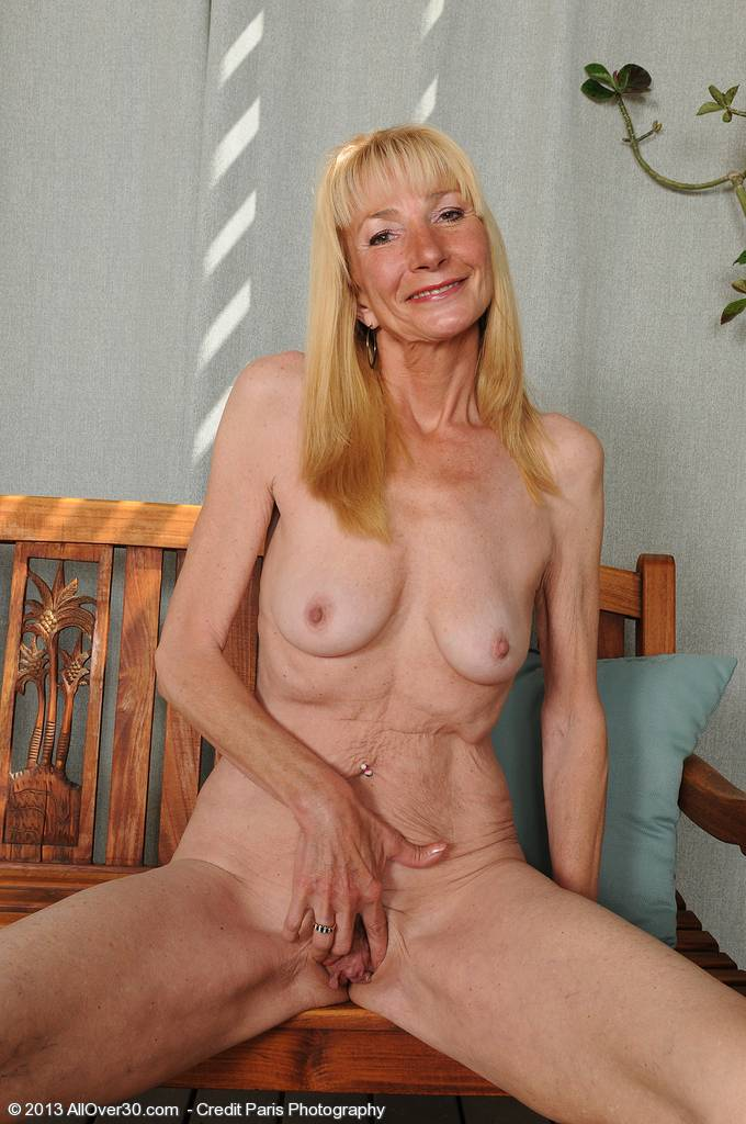 Gorgeous mature Pam gets naked and spreads in the backyard at AllOver30