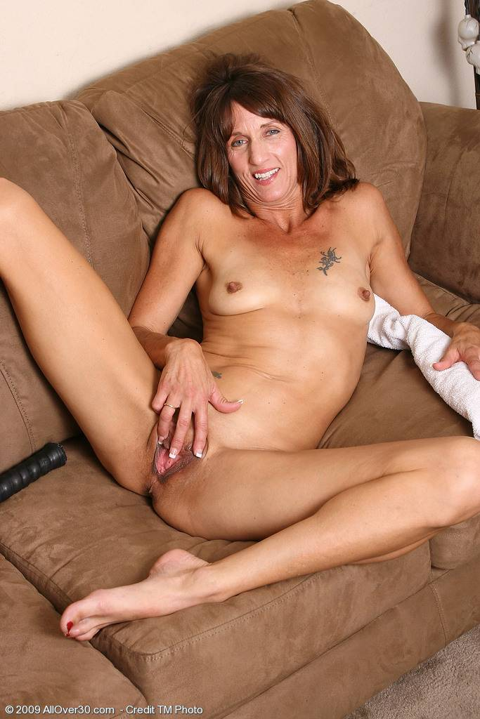 Athletic and mature Rose works her pussy out after playing tennis at AllOver30
