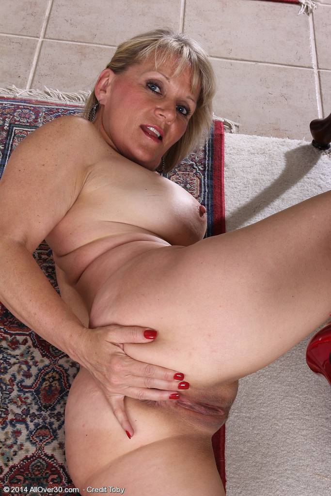 Horny blonde Sherri Donovan pulling her mature ass cheeks apart at AllOver30