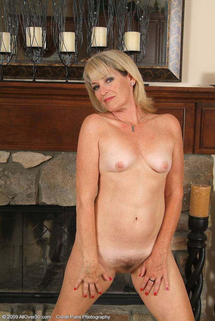Elegant and mature blonde Tina shows off her trimmed pussy here at AllOver30