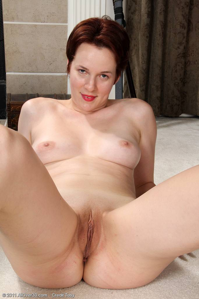 Redhead MILF Vada working out her body in the nude at AllOver30