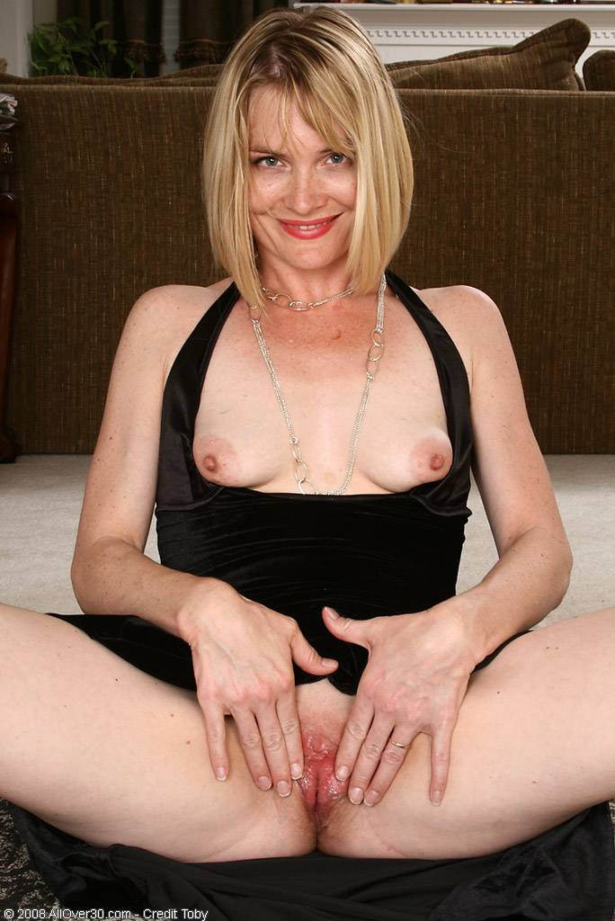 Elegant and mature Brittany slips of of her black dress in here at AllOver30