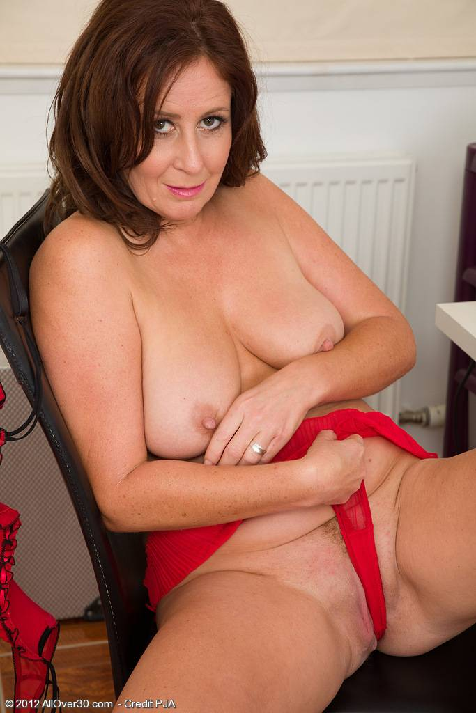 Carol Foxwell massages her pussy at the makeup table at AllOver30