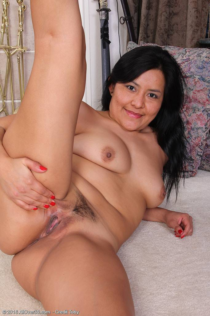 Exotic mature CiCi Jones shows off her shaved pussy at AllOver30