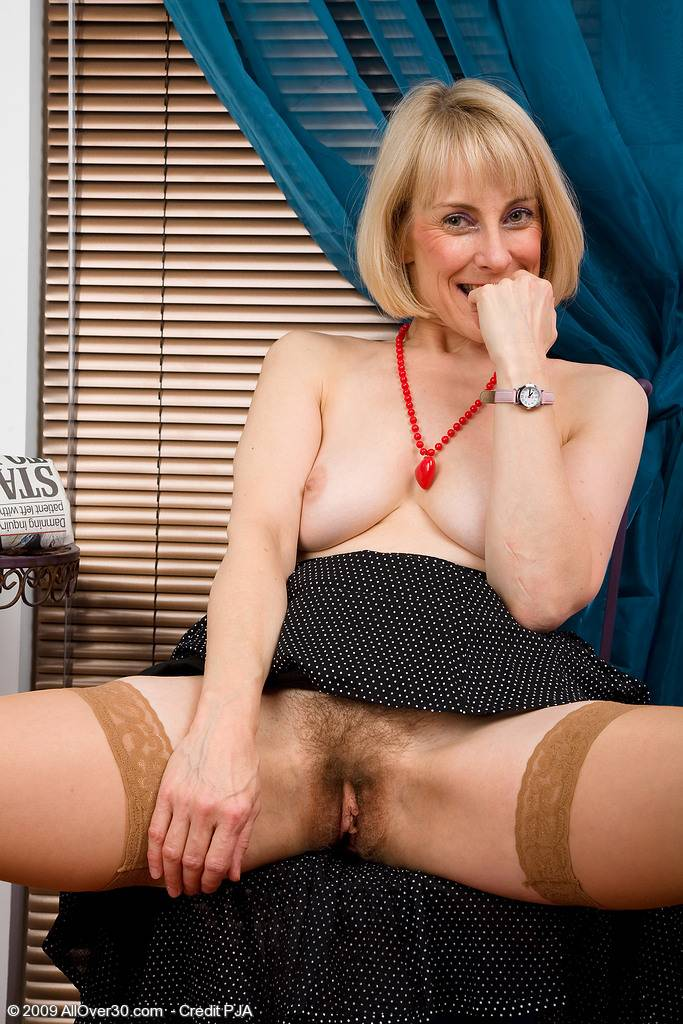 Mature Hazel shows off her hairy pussy at AllOver30