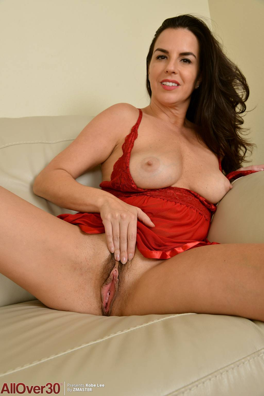 Brunette mature Kobe Lee in red lingerie at AllOver30