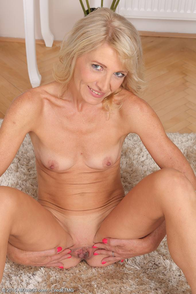 Hot mature Laura Fabroni will sweep you off your feet as she strips down at AllOver30