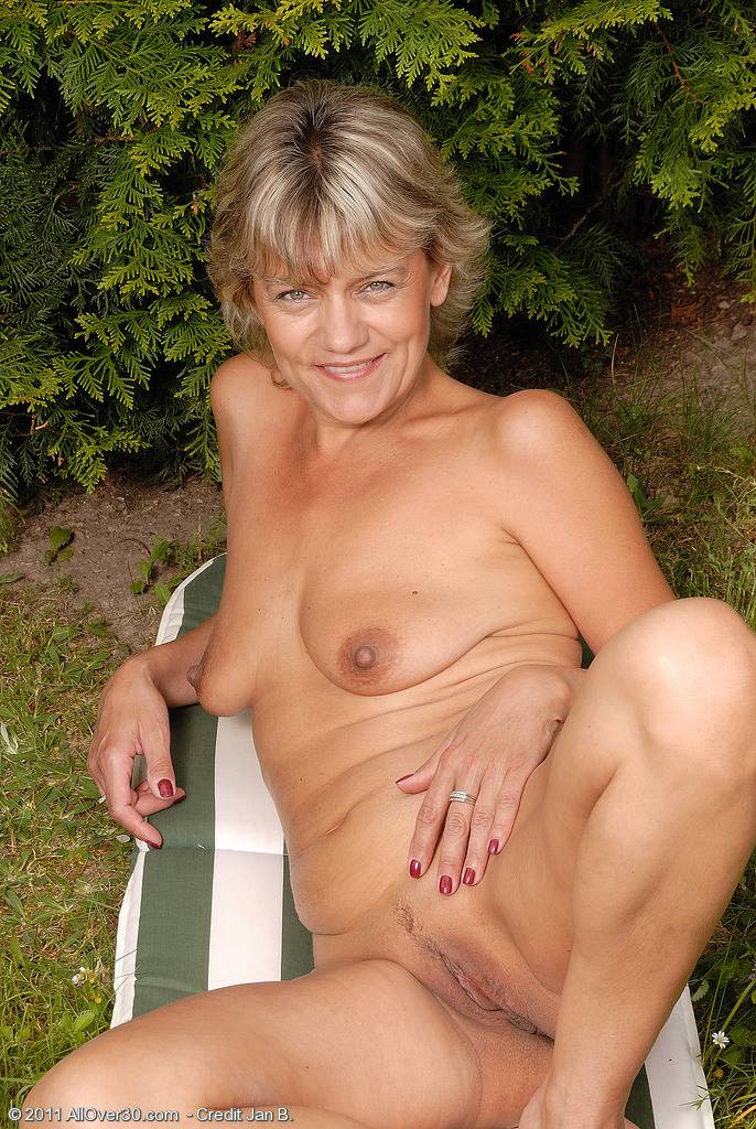 Blonde housewife Sherry D enjoying her backyard naked at AllOver30
