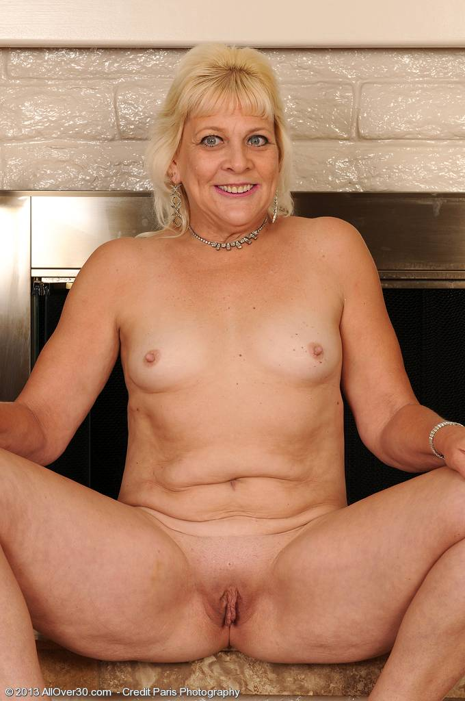 Blonde mature Sindy Silver removes her lingerie and spreads at AllOver30