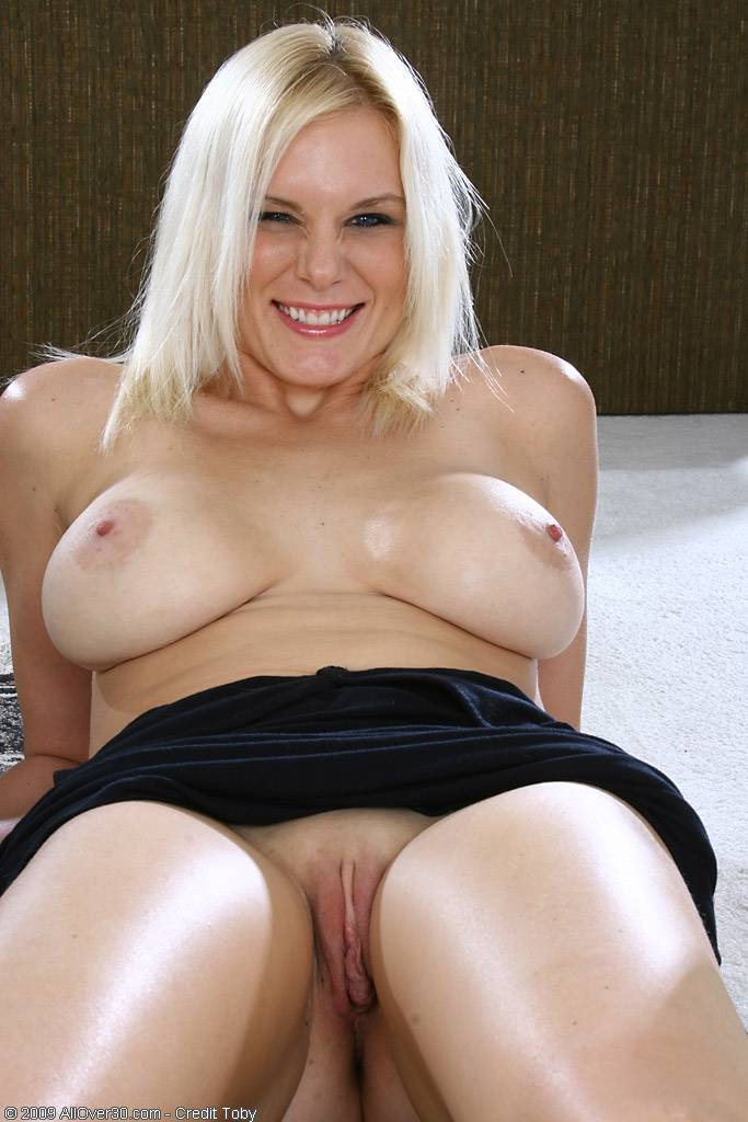 Gorgeous blonde Slovanna shows of her big tits and mature pussy at AllOver30