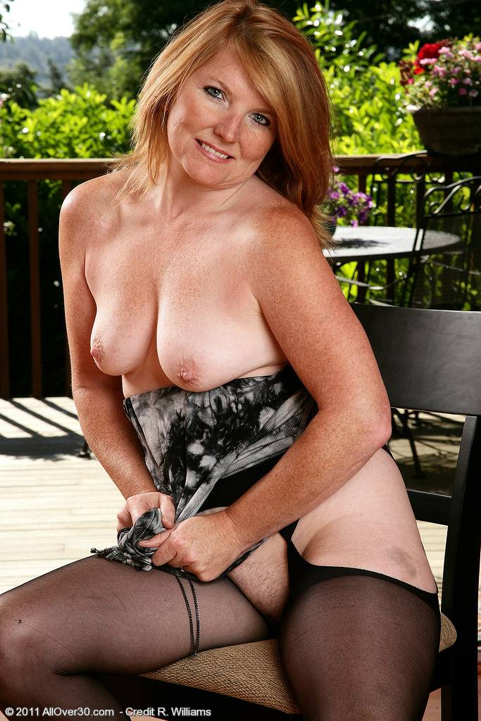 Mature Stacie posing in and out of her dress at AllOver30