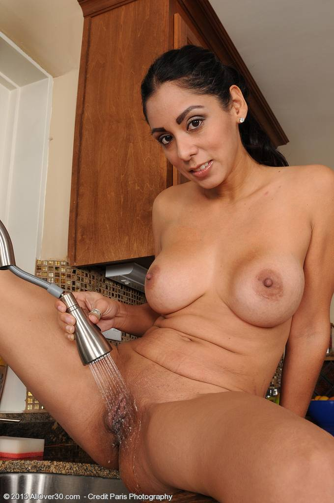 Sexy and exotic 33 year old Bianca Mendoza sprays down her box at AllOver30