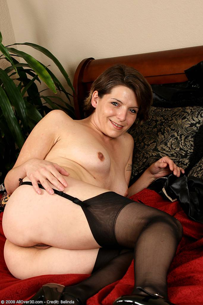 Tight pussied MILF shows off her leopard skin lingerie in here at AllOver30