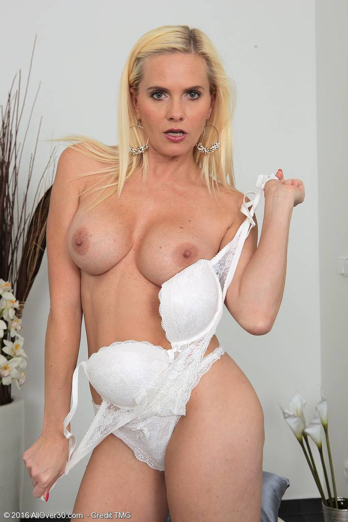 Stunning stacked blonde Lilly Peterson strips out of her sexy white lingerie at AllOver30