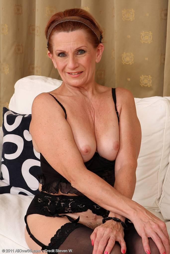 Mature housewife Lucy O peels her 58 year old pussy lips apart at AllOver30